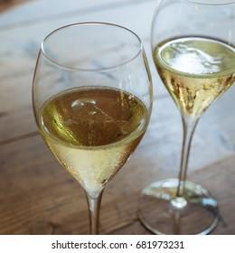 Flutes filled with sparkling prosecco, in a restaurant in Conegliano. Prosecco is a white sparkling wine cultivated and produced in Valdobbiadene-Conegliano area.