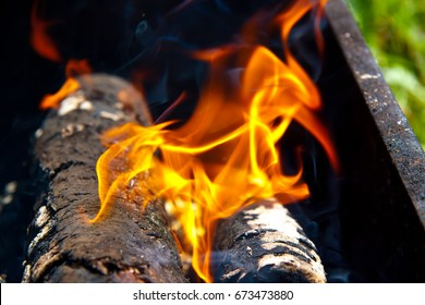 A flutter of fire rises from the brazier
