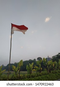 Fluttering indonesia flag with background blue sky