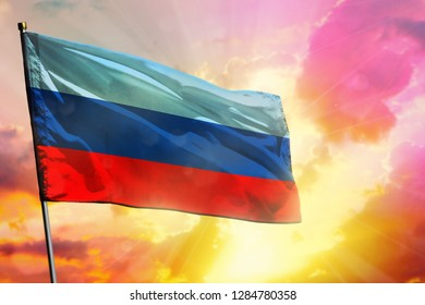 Fluttering Luhansk Peoples Republic flag on beautiful colorful sunset or sunrise background. Luhansk Peoples Republic success and happiness concept.
