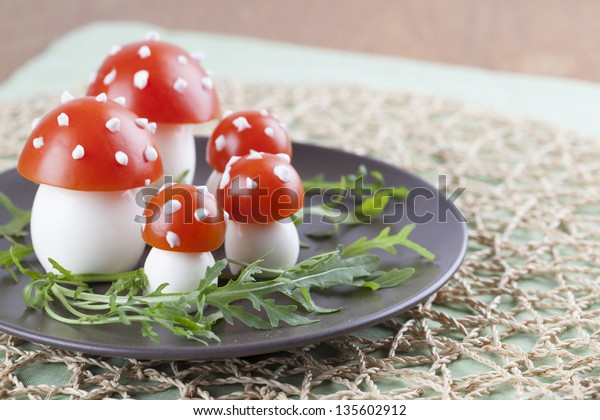 Fly agaric mushrooms made from tomatoes and chicken and quail eggs