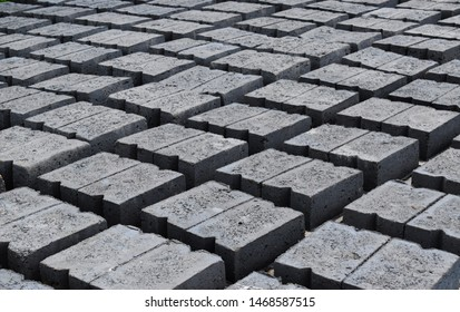 fly ash bricks drying outdoors in line
