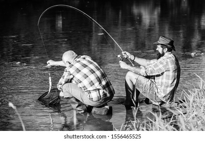 fly fish hobby of men. retirement fishery. retired father and mature bearded son. Two male friends fishing together. happy fishermen friendship. big game fishing. relax on nature. Ready for fishing.