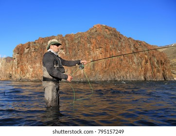 fly fisherman with beautiful background