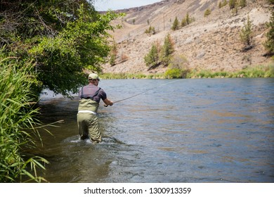 Fly fisherman casting to rising native redside rainbow trout on the Lower Deschutes River in Oregon. The Deschutes is listed as Wild and Scenic.