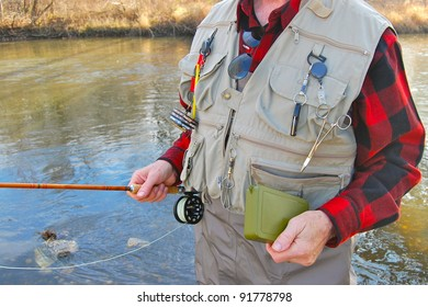 Fly Fisherman with Fishing Gear