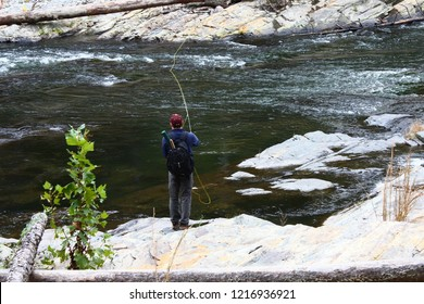 Fly fisherman fishing in Mountain Fork River  at Beavers Bend State Park in Broken Bow Oklahoma.