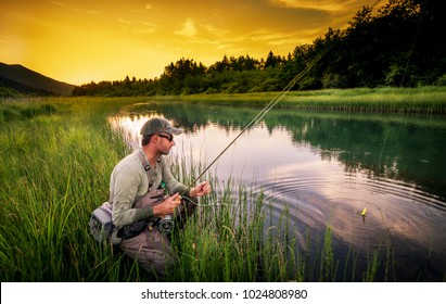 Fly fisherman fishing pike in river