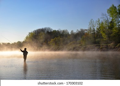 Fly fisherman fishing for Striped Bass in Nova Scotia.