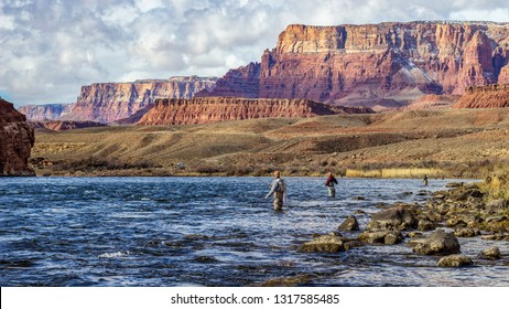 Fly Fisherman on the Colorado river near Lees Ferry AZ fishing for rainbow trout,