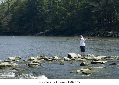 A fly fisherman on a river in Falmouth, Maine