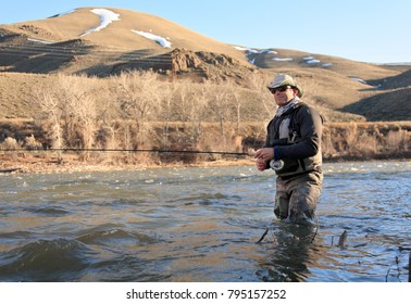 fly fisherman on river in Idaho