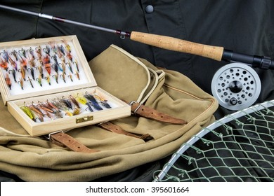 Fly fishing tackle with bag and net on outdoor coat