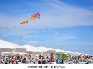 Fly the kite over the umbrellas a summer day