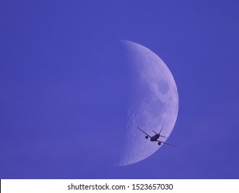 Fly me to the moon - airplane flying towards the moon