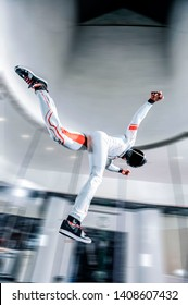 Fly Men. Levitation in wind tunnel. Indoor sky diving. Team flyers. Yoga fly in wind tunnel. Indoor skydiving.