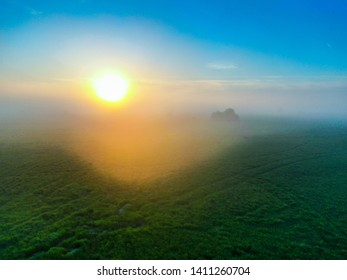 Fly over the sunset int the fog