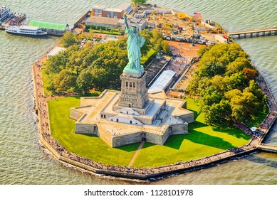 Fly over, view Statue of Liberty (Liberty Enlightening the world) near New York and Manhattan from a bird's eye view.