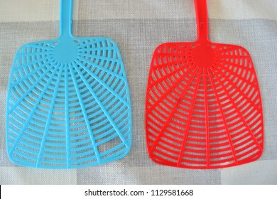 Fly swatters on a white