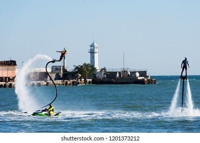 Flyboard in the waters of the port of Yalta. Crimea, August 11, 2018