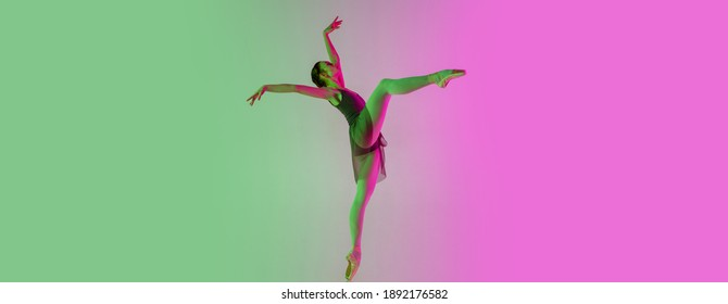 Flyer, copyspace. Young and graceful ballet dancer isolated on gradient pink-green studio background in neon. Art, motion, action, flexibility, inspiration concept. Flexible ballerina, weightless