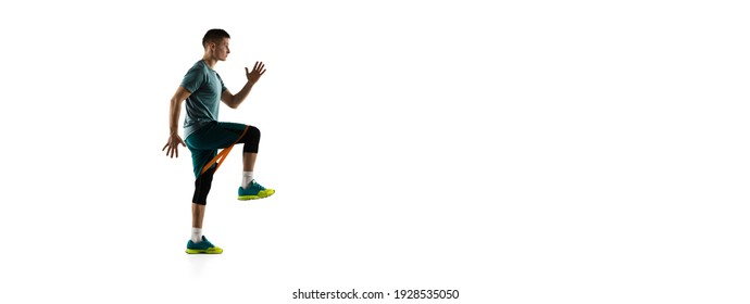 Flyer. Young caucasian male model in action, motion isolated on white background with copyspace. Concept of sport, movement, energy and dynamic, healthy lifestyle. Training, practicing. Authentic.