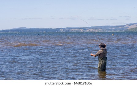 Flyfisher standing in ocean in New Zealand
