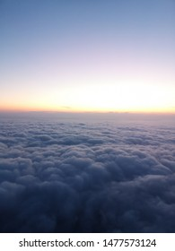 Flying above the clouds and see the horizon