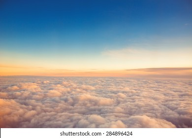 Flying above the clouds. view from the airplane, soft focus