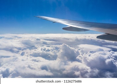 Flying above the sky. Shape of the airplane wing on a blue sky.