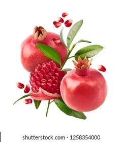Flying in air fresh ripe whole and cut pomegranate with seeds and leaves isolated on white background. High resolution image
