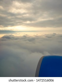 Flying aircraft turbine against blue sky.