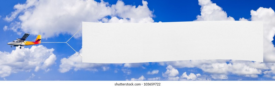 Flying airplane and banner, sky on background
