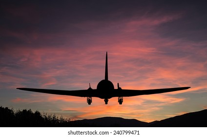 Flying airplane with landscape silhouette.