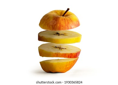 Flying Apple Sliced apple isolated on white background. Levity fruit floating in the air concept. - Shutterstock ID 1930365824