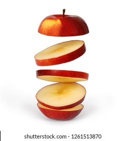 Flying apple. Sliced red apple isolated on white background with clipping path. Levity fruit floating in the air. Creative concept with flying fruits.
