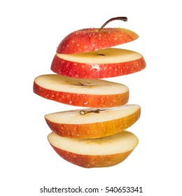Flying apple. Sliced red apple isolated on white background. Levity fruit floating in the air