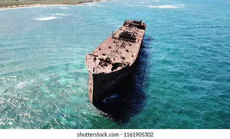 Flying around the front of the old US Navy shipwreck off the coast of Lanai Island Hawaii Shipwreck Beach