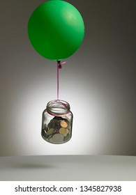 Flying balloon with saving jar. Rappresenting the outgoings or earnings and your savings .