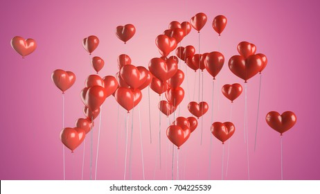 Flying balloons in the shape of a heart.