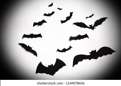 Flying bats over a white background with vignette effect giving sense of halloween.