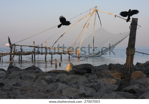 Flying birds against a background of chinese fishing net