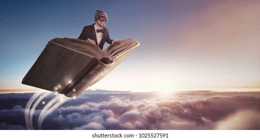 Flying book over the clouds