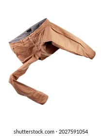 Flying brown trousers on white background