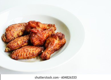 Flying chicken wings close up on white background