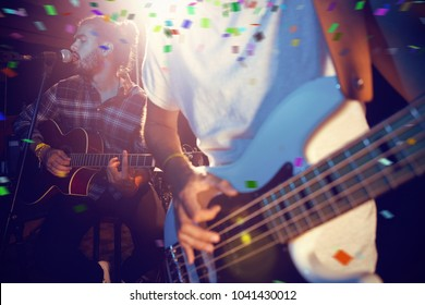 Flying colors against guitarists performing on stage
