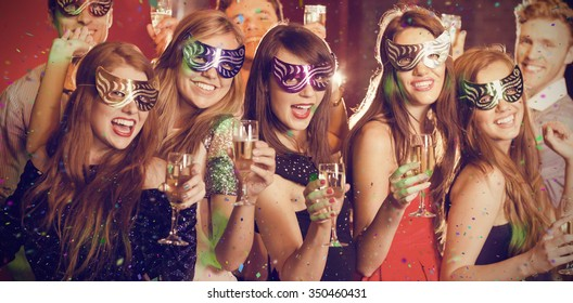Flying colours against friends in masquerade masks drinking champagne