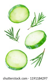 Flying Cucumber slices with rosemary leaves on a white background. tinting. selective focus