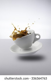 Flying cup of coffee with splash