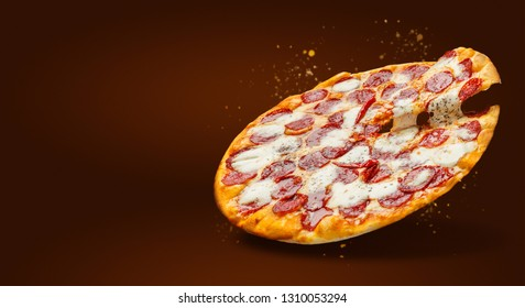 Flying delicious pizza with cheese and salami over dark background with free space